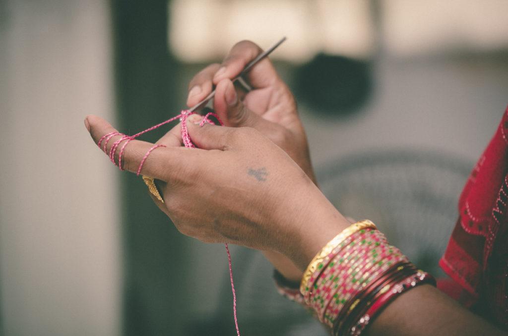 hands making crochet