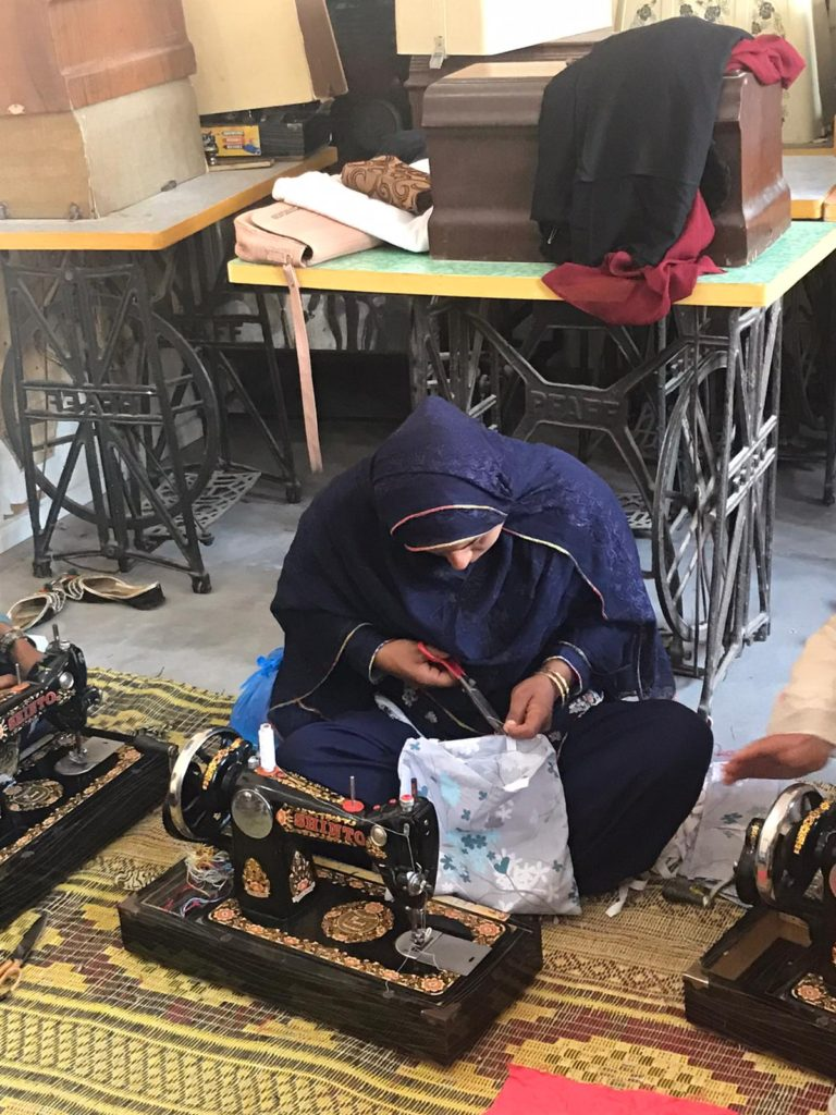 person and sewing machines
