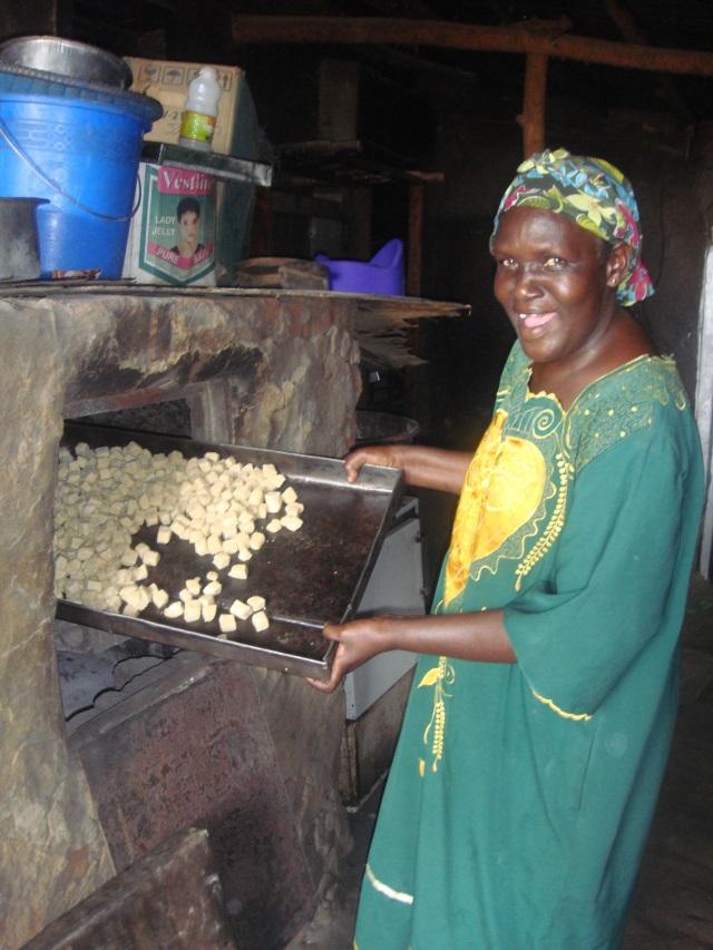 woman cooking, Uganda