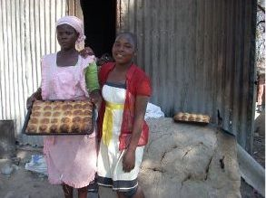 people holding tray of bread